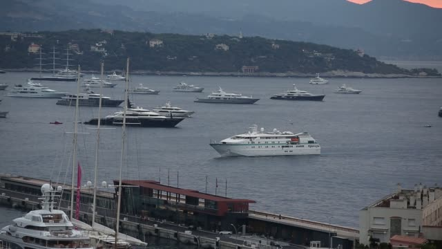 various wide high angle views of superyachts and other vessels moored in the port hercules harbor on day one of the monaco yacht show in monaco,... - exklusiv stock-videos und b-roll-filmmaterial