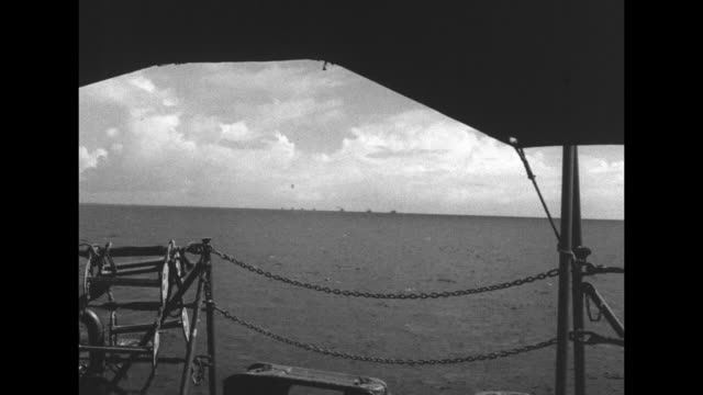 various wide shots from ship of target ships on horizon to be used in operation crossroads us atomic bomb test at bikini atoll / note exact day not... - bikini atoll stock videos & royalty-free footage