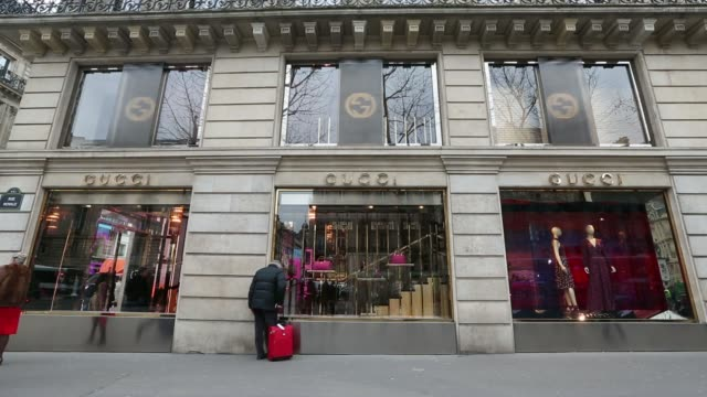 various wide shots pedestrians walk past a gucci store, a luxury retail unit of kering sa, in paris, france, on tuesday, feb 18 various general views... - design professional stock videos & royalty-free footage