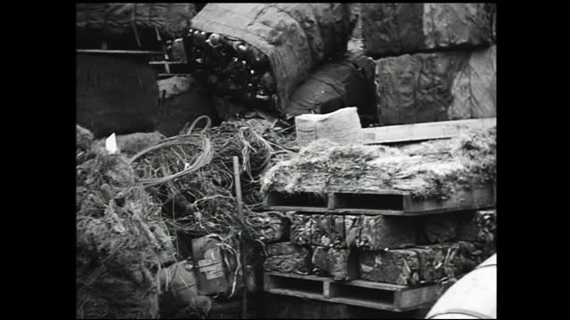 various wiring; man burning piles of wiring in a yard; man tending furnace with a gas mask; stable views of stacks of wiring; push in view of factory... - 1940 1949 stock videos & royalty-free footage