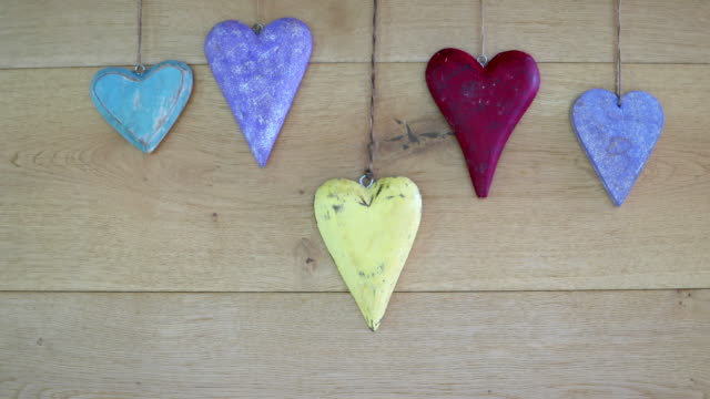 various wooden hearts slowing being dragged out of the frame - five objects stock videos & royalty-free footage