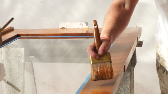 ecu of varnish applied by brush to custom wood door frame - wood material stock videos & royalty-free footage