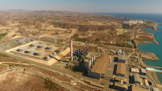 vasilikos power station after disaster located between larnaca and limassol . cyprus. aerial drone shot. - coal fired power station stock videos and b-roll footage