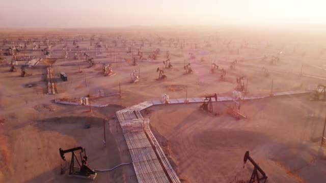 vast california oil field - drone shot with tilt - pipeline stock videos and b-roll footage