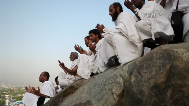 vast crowds of muslim pilgrims all dressed in white flocked from early thursday to mount arafat in saudi arabias west where it is believed prophet... - hajj stock videos & royalty-free footage