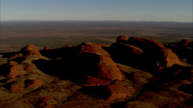 vast desert and red domed rock formations surround mount olga in australia. - northern territory australia stock videos & royalty-free footage