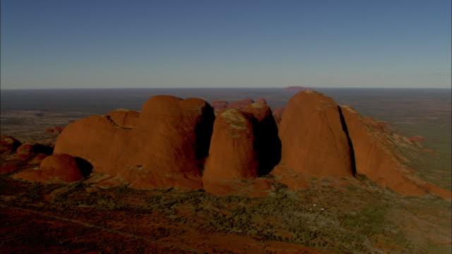 vast desert surrounds mount olga in australia's northern territory. - northern territory australia stock videos & royalty-free footage