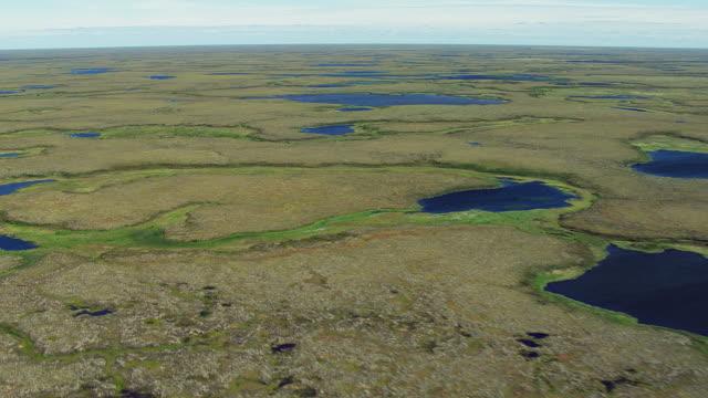 vidéos et rushes de vast landscape dotted with lakes - hémisphère nord