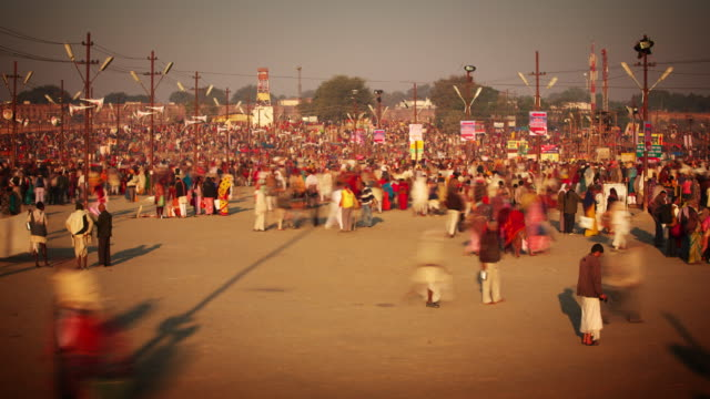 A vast mingling colourful crowd at the Kumbh Mela, India