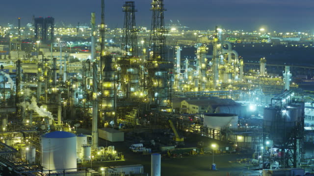 Vast Oil Refinery Complex Lit Up at Night - Drone Shot