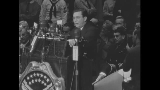 vast stadium crowd with a person waving a hand fan in foreground / former republican party presidential candidate wendell willkie acknowledges the... - hand fan stock videos & royalty-free footage