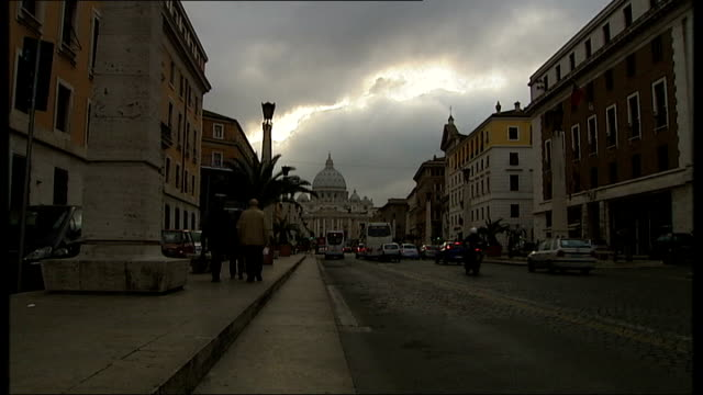 vatican city ext wide shot of road with st peter's basilica in distance mid shots of st peter's basilica - mid distance stock videos & royalty-free footage