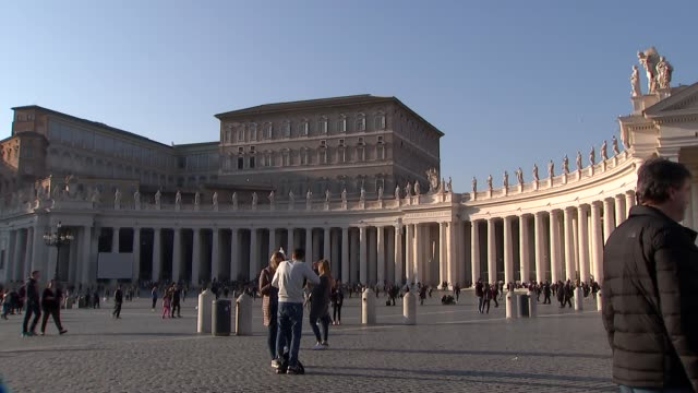 vatican city general views; vatican city: gvs vatican city / st peter's square / st peter's basilica /nuns along / people along - basilica video stock e b–roll