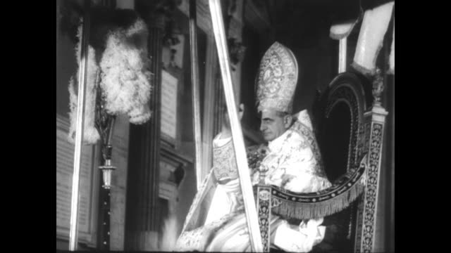 EXT Vatican City / inside cardinals in white perform opening ceremony of ecumenical council / Pope Paul VI carried into the Basilica / CU dove window...