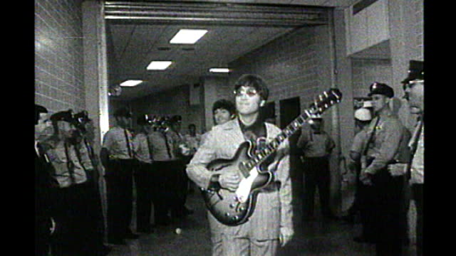 vatican forgive john lennon for jesus remark x24086601 motion footage of john lennon and other beatles along corridor carrying guitars b/w footage of... - john lennon stock videos and b-roll footage