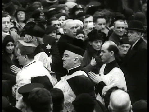 stockvideo's en b-roll-footage met vatican hallway italian priests walking through crowd lined w/ policemen pope pius xi reading service on platform w/ other clergy seated in ornate... - priester