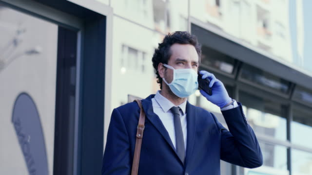 i've just left the office... - surgical mask stock videos & royalty-free footage