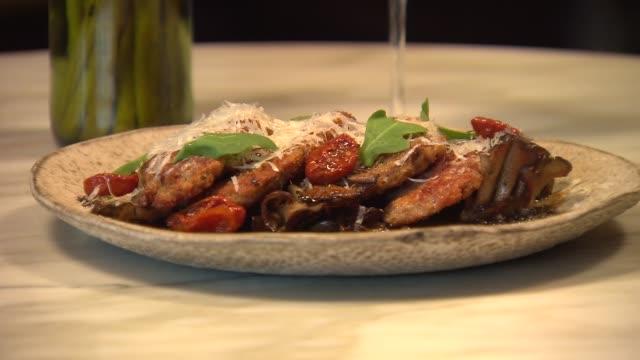 veal parmigiana at acanto restaurant on nov 5 2014 in chicago - kalbfleisch stock-videos und b-roll-filmmaterial