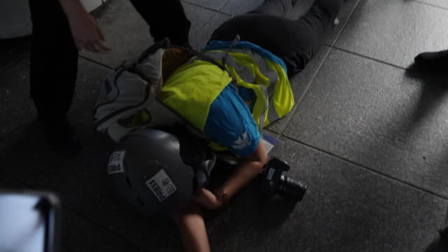 stockvideo's en b-roll-footage met veby mega indah, an indonesian journalist receives medical attention after being shot in the face with a police projectile on sunday, will end up... - journalist