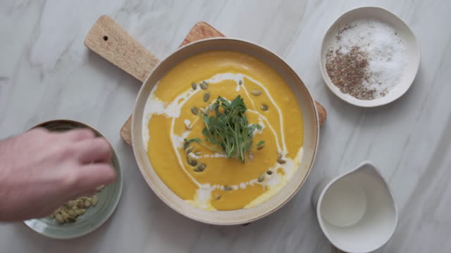 vegan creamy roasted pumpkin soup - recipe stock videos & royalty-free footage