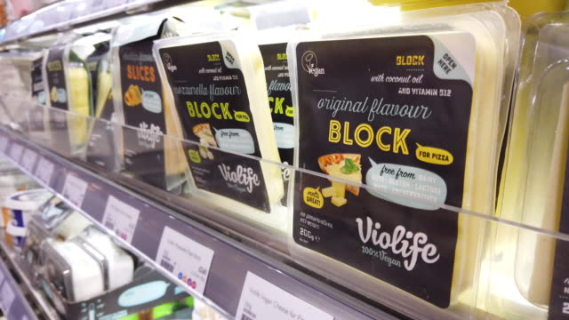 vegan dairy-free products available in a branch of the planet organic healthfood store on january 03, 2020 in london, england. veganuary, a campaign... - vegan stock videos & royalty-free footage