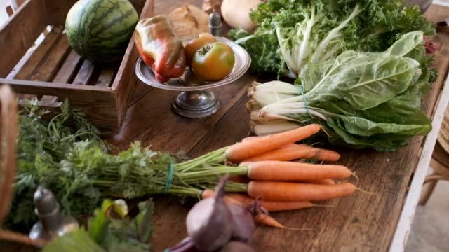 vegan meal still life on a wooden table. - vegetable stock videos & royalty-free footage