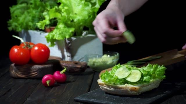 vegan sandwich with avocado, radish and cucumber - crucifers stock videos & royalty-free footage