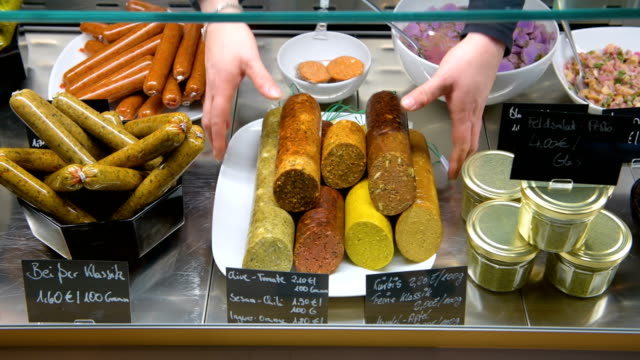 vídeos de stock, filmes e b-roll de vegan sausage products are displayed at the vegan butchery vetzgerei by owner sarah pollinger on january 25 2018 in berlin germany the butchery... - vegan