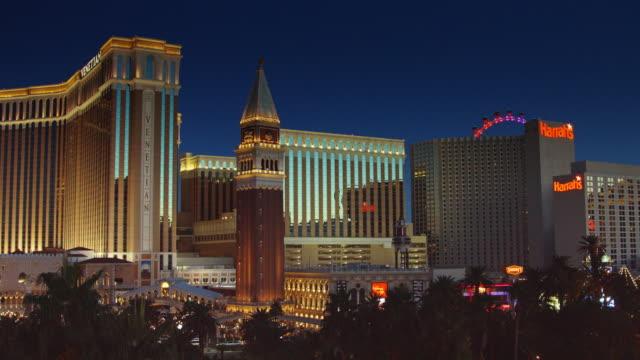 vegas casinos lit up at night - venetian hotel las vegas stock videos & royalty-free footage
