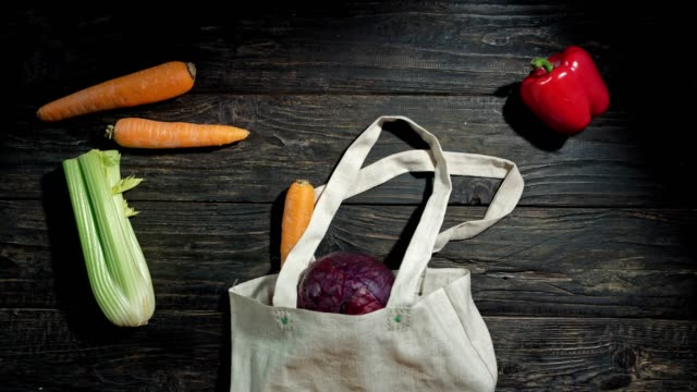 vegetable crawling out shopping bag - bag stock videos & royalty-free footage