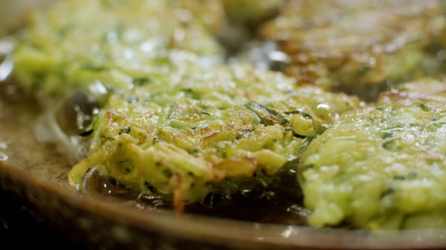 vegetable fritters - courgette stock videos and b-roll footage