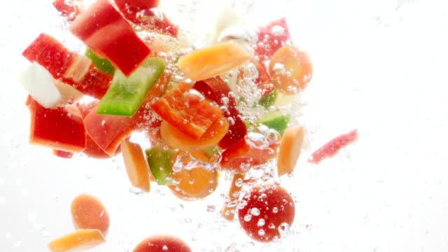 vegetable pieces falling into water - carrot stock videos and b-roll footage