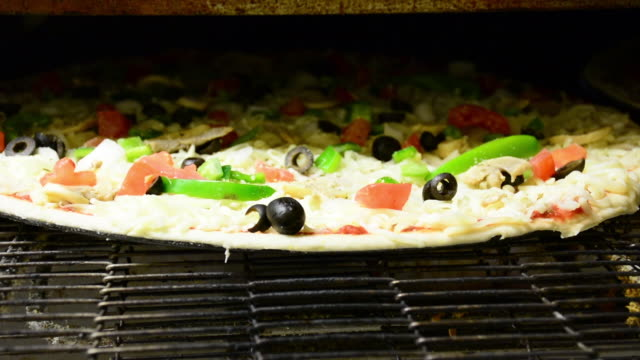 CU Vegetable pizza bakes in a restaurant style oven