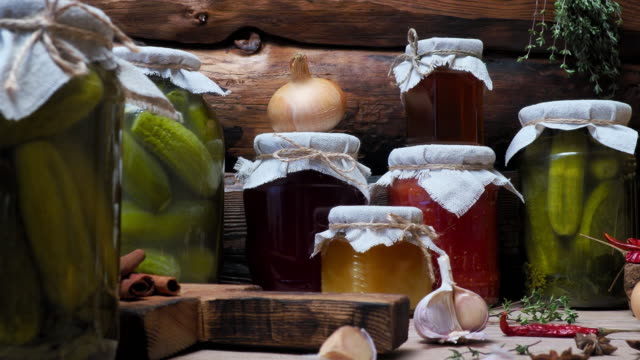 vegetable preserves on kitchen table - pickled stock videos and b-roll footage