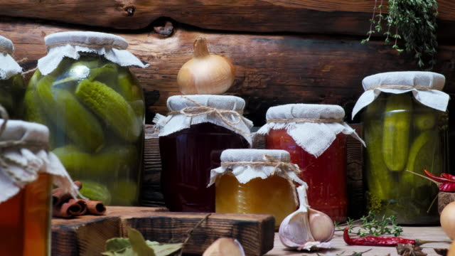 vegetable preserves on kitchen table - canning stock videos & royalty-free footage