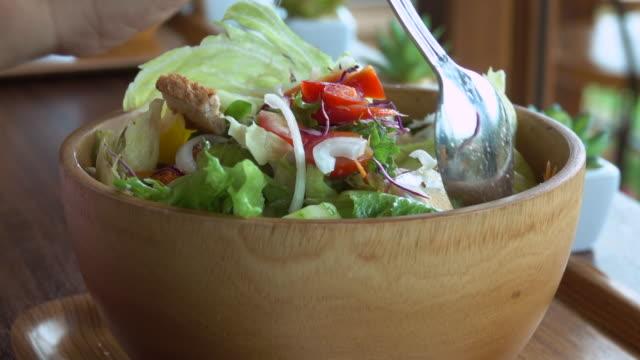 vegetable salad in wood bowl - salad stock videos & royalty-free footage