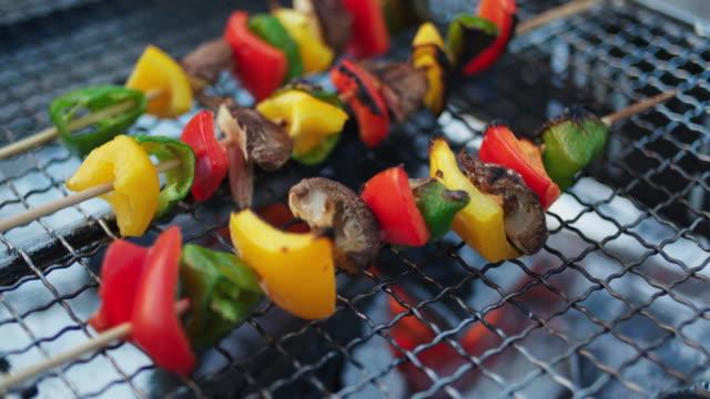 vegetable skewers cooking on a barbecue - skewer stock videos & royalty-free footage
