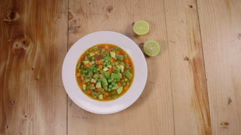 vegetable soup. top view of a bowl of vegetable soup. - soup stock videos & royalty-free footage