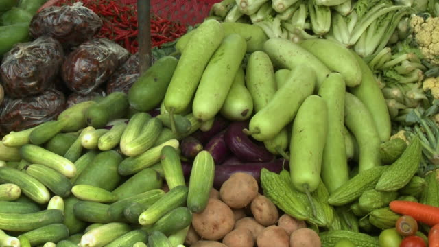 vegetable varieties on display in a local market - gourd stock videos and b-roll footage