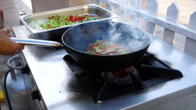 4K, Vegetables cooking on pan