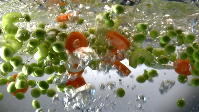 vegetables in boiling water - boiling stock videos & royalty-free footage