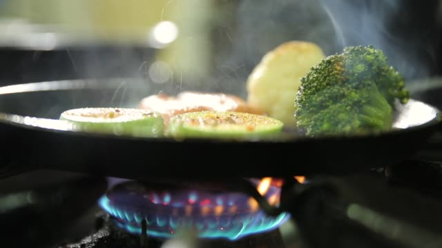 vegetables on frying pan, gas stove - cooking pan stock videos & royalty-free footage
