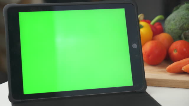 vegetables on the table with tablet to learn how to cook - recipe stock videos & royalty-free footage