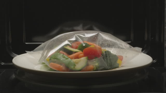 vegetables steam in the microwave. - microwave stock videos & royalty-free footage