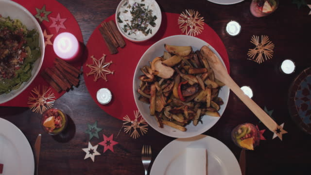 vegetarian christmas dinner on festive table - vegan food stock videos & royalty-free footage