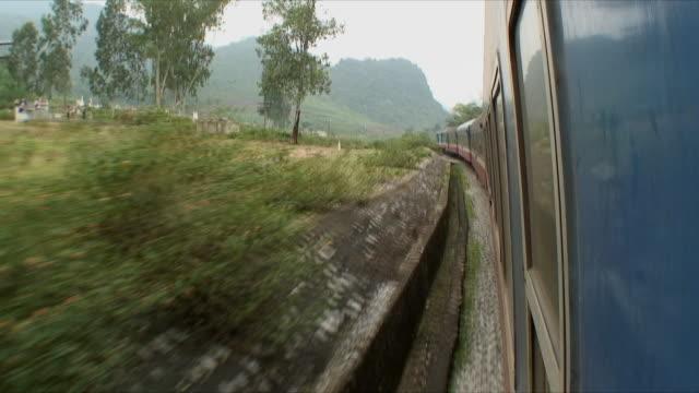 ws pov vegetation along train tracks, northern countryside, vietnam - vietnam stock-videos und b-roll-filmmaterial