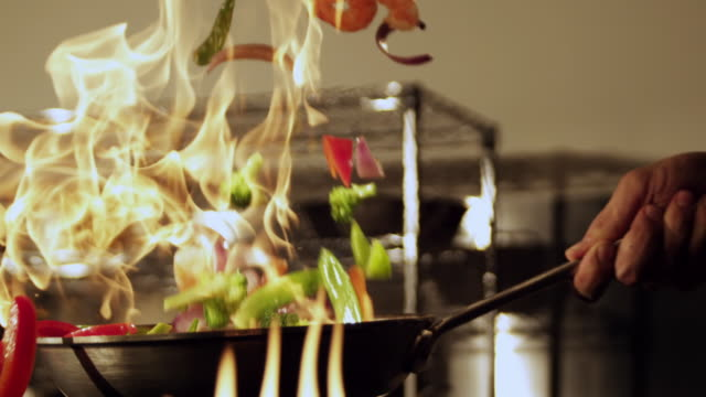 veggie saute over flames - saute stock videos and b-roll footage