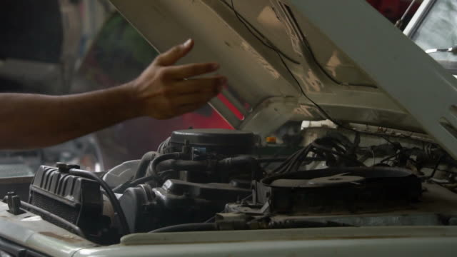 vehicle breakdown with smoking car engine - mechanic stock videos & royalty-free footage