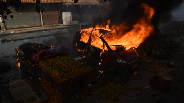 vehicle burning on the street on 24, 2020 in delhi, india. the citizenship amendment act, a controversial law passed by the indian government that... - citizenship stock videos & royalty-free footage
