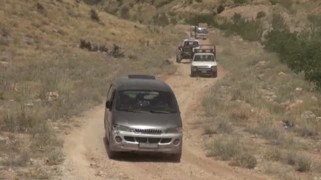 a vehicle convoy carrying approximately a group of 100 syrian refugee are seen on the way to back their home country in arsal district of baalbek... - lebanon country stock videos & royalty-free footage